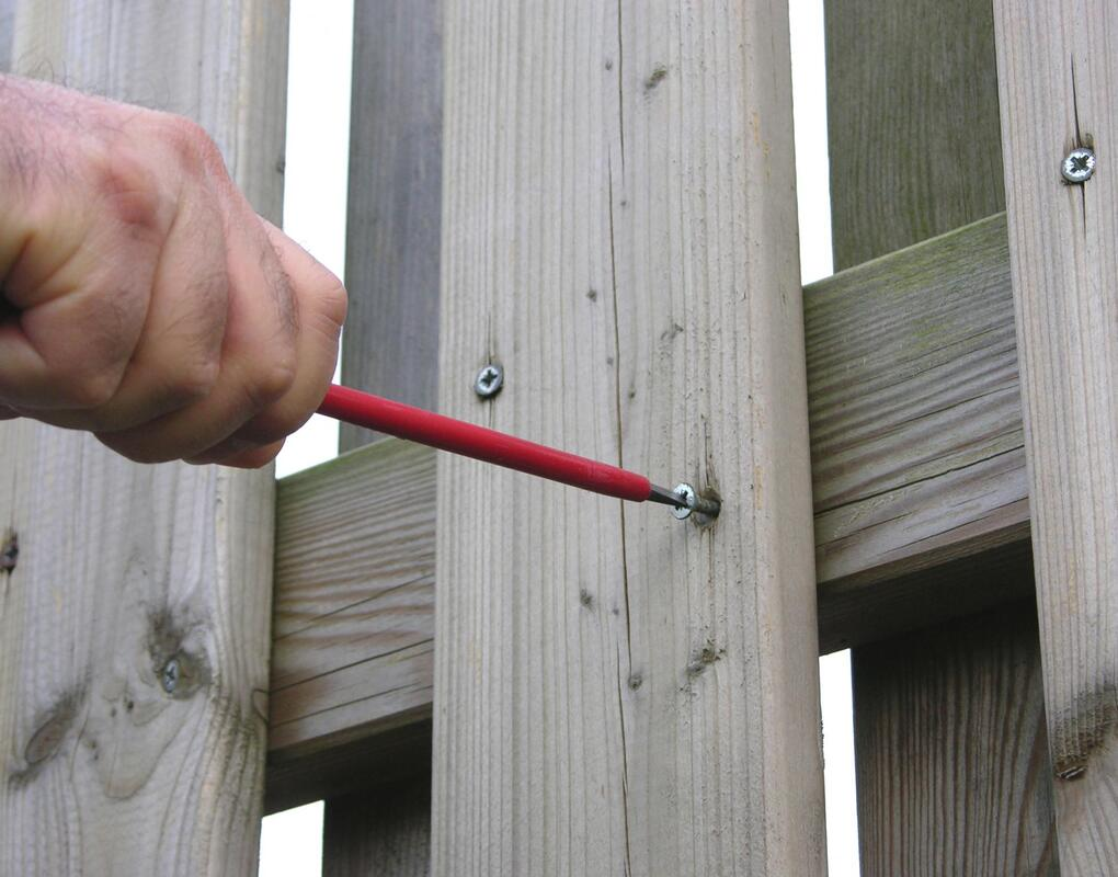 man screwing the nail on the wood